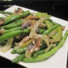 Not Your Everyday Green Beans - This side dish offers fresh green beans cooked with crimini mushrooms and sprinkled with toasted almond slices.