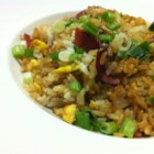 Fried Rice I - White rice is fried with eggs, bacon, soy sauce, green peas and green onions.