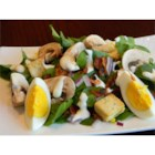 Spinach, Bacon, and Mushroom Salad - Fresh spinach and mushrooms are tossed with hard-cooked eggs and bacon in this salad.