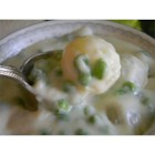 Creamed Peas and Onions - In this classic accompaniment to a holiday meal, frozen peas and pearl onions are stirred into a basic white sauce.