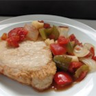 Creole Pork Chops - A homey recipe for pork chops simmered in a savory, chunky tomato sauce. This is also delicious simmered in a slow cooker for 5 or 6 hours.