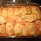 Cabbage Rolls - Savoy cabbage leaves are stuffed with ground beef, ground sausage and rice in this traditional dish.