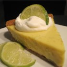 Easy Key Lime Pie I - To make this tart and creamy blue ribbon pie, egg yolks, lime juice and condensed milk are stirred together, poured into a graham cracker crust, and baked.