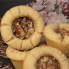 Pecan Pie Cookies - Mini pecan pie-shaped cookies filled with a rich pecan filling are something different for your cookie tray this year.