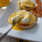 Eggs Benedict - Hot buttered English muffins, Canadian-style bacon, and poached eggs are topped with a heavenly drizzle of hollandaise sauce. The best brunch in the world!