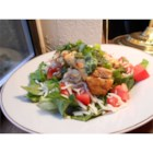 Balsamic Chicken Salad - This recipe is a salad version of a popular Allrecipes main dish. Chicken tenders and portobello mushrooms are marinated in balsamic vinaigrette, then served on crisp lettuce with cherry tomatoes, green onions, mozzarella cheese, and basil.