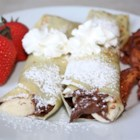 Chocolate Hazelnut Fruit Crepes - Can you say yum!!! I had these at a French breakfast restaurant, this recipe is the closest I can get it. Its so quick and easy but looks and taste like a gourmet breakfast! You can use any fruit you would like - strawberries, kiwi, pineapple are all great too !!