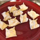 Crab Rangoon I - This Asian appetizer relies on ready-made wonton wrappers for its crunchy coating; minced cilantro gives the seafood stuffing a modern kick.