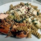 Salmon Pasta with Spinach and Artichokes - Pesto-coated salmon flavors this colorful spinach and artichoke pasta dish.