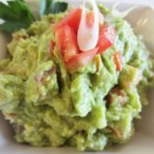 Ellen's Addictive Guacamole - This tasty guacamole uses the traditional ingredients of avocados, onion, tomatoes, and lemon juice.