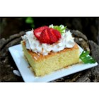 Pastel de Tres Leches (Three Milk Cake) - A sponge cake is soaked in a mixture of three kinds of milk and topped with whipped cream and optional strawberries.