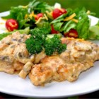 Perfect Chicken - Chicken thighs are pan-fried to a golden crust and baked in a creamy mushroom and wine sauce flavored with lemon and capers.