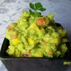 Savory Mango Guacamole - This mango guacamole puts a twist on the traditional ingredients for a sweet and savory flavor. Enjoy with chips!