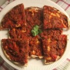 Lahmahjoon (Armenian Pizza) - These savory pizzas are bathed in a tomato and lamb topping, then cut into wedges to serve. Served hot or cold, these may be an appetizer, or put a little salad in the middle, and fold up like a taco for a quick meal.