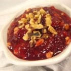 Cranberry Walnut Relish I - Orange marmalade is stirred into cranberries and walnuts in this oven-baked relish.
