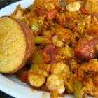Shrimp, Sausage, and Fish Jambalaya - This take on jambalaya uses shrimp, andouille sausage, and cod in a well-seasoned rice and tomato mixture for a large pot of delicious.