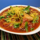 Southwestern Turkey Soup - Shredded leftover turkey is cooked with tomatoes and green chiles, spiced with cayenne and cumin and finished off with fresh avocado and dried cilantro for a zesty, unusual soup.