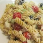 Macaroni Tuna Salad - A chilled macaroni salad with mayonnaise, white tuna, olives, and grape tomatoes makes a good side dish for grilled foods, or a light and easy meal on its own.