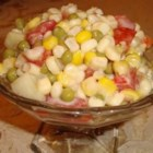 Kim's Summer Corn Salad - This summery vegetable combo is the perfect quick side dish to prepare before you head over to the big cookout!