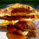 French Egg and Bacon Sandwich - A delicious French toast and bacon sandwich.