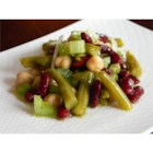 Three Bean Salad With Celery - This three bean salad has the addition of celery for extra crunch. It is tossed in a white wine vinaigrette for a quick and easy salad that is perfect for picnics.