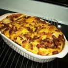 Most Excellent Breakfast Casserole - This hearty and flavorful casserole is made with sausage, bacon, eggs, bread slices, and two kinds of cheese.