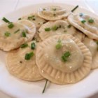Mushroom and Spinach Ravioli with Chive Butter Sauce - This homemade ravioli is actually vegetarian, but no one who tries it can tell! The savory filling contains three different cheeses, mushrooms, and spinach. Although it's a rather time-consuming recipe to prepare, the results are well worth it!
