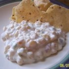 Spicy Corn Dip - A can of Mexican-style corn adds texture, taste and color to this standard Southwestern dip.