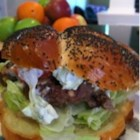 Greek Lamb-Feta Burgers With Cucumber Sauce - These grilled lamb burgers are served with slices of ripe tomatoes and red onion in pita bread with a fresh tasting cucumber sauce seasoned with fresh mint and garlic.