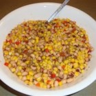 Cold Black-Eyed Peas and Corn - This tasty salad doubles as a dip for your favorite tortilla chips. Canned black-eyed peas and corn make it super easy to toss together.