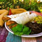 Pollo Fajitas - Fajitas at home! Chicken briefly steeps in a zesty marinade before a saute with onions and peppers in this faithful rendition of a Mexican favorite. Serve with warm flour tortillas, salsa and sour cream to complete the picture.