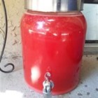 Easy Punch - Strawberry drink mix and pineapple juice stirred with sugar, water and ginger ale.