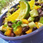 Cucumber, Mango, and Black Bean Salad - Cucumber, mango, and black beans are tossed together with lime juice and cilantro for a refreshing and crunchy salad.