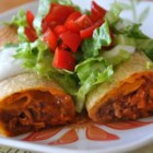 Chicken Chimi in the Oven - A fragrant, spicy chicken mixture is rolled up in flour tortillas and baked. This is my absolute favorite recipe! Serve with salsa, sour cream, and guacamole.