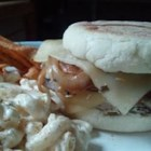 Chicken Melt - An English muffin sandwich made with sauteed onions and rosemary chicken, oozing with melted Swiss cheese.