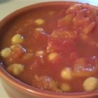 College Student's Saucy Chickpeas - An easy to assemble dish of chickpeas in a curry tomato sauce that is cooked in the microwave.  Serve with plain rice or noodles.