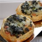 Spinach-Cheese Swirls - Savory spinach, onion and tangy cheese filling is rolled up in flaky puff pastry for tempting appetizer pinwheels.