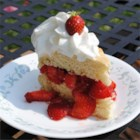 Strawberry Shortcake - An old-fashioned, tender shortcake with two layers of strawberries topped with whipped cream.