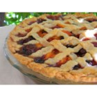 Summer is Here Triple Berry Peach Pie - Fresh, juicy peaches, strawberries, blueberries, and raspberries bake up in a pie that just screams 'summer is here!'