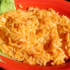 Easy Authentic Mexican Rice - This Mexican rice is cooked with a potato, onion, and tomato sauce for an easy side dish. Add green bell pepper, red bell pepper, or fresh tomato into the rice before simmering for extra flavor and color.