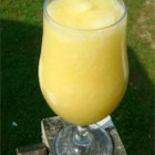 Fuzzy Navel Slush - Orange juice, lemonade and peach schnapps are frozen into a slush, then drunk with lemon-lime soda.