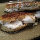 S'more Sandwiches - A friend showed us this creation on a camping trip.  If you have pie makers, AKA tonka toasters, campfire irons, etc., these are a great dessert and a nice twist on the s'more idea. This can be done in the frying pan too, but it's much more fun over an open flame.