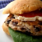 Black Bean Turkey Burgers - Japanese-style bread crumbs, egg, and Parmesan cheese help keep these ground turkey burgers with black beans hold their form on the grill.