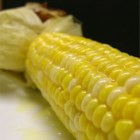 Juicy Grilled Corn On The Cob - Ears of shucked corn get a sweet, salty soak for extra flavor before hitting the grill.
