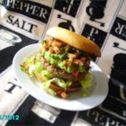Hamburguesas Mexicanas - Mexican-inspired burgers laced with pepperjack cheese and onions are topped with homemade pico de gallo and guacamole for a hearty sandwich.