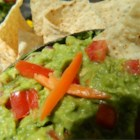 Habanero Guacamole - Habanero peppers and cayenne pepper combine to bring the heat to this creamy version of guacamole.