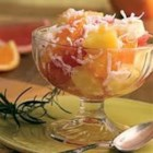 Momma Legs Ambrosia - Fresh oranges and apple are tossed with pineapple, coconut, and cherries in this fruit salad recipe.