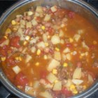 Cowgirl Stew - This is a pretty simple stew recipe using ground beef, potatoes, corn, and ranch-style beans simmering in a tomato-based sauce.