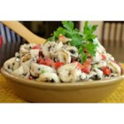 Tortellini Picnic Salad - Cheese tortellini tossed with feta cheese, walnuts, and black olives will have everyone coming back for seconds at your next get-together.