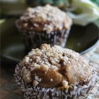 Cream Cheese Filled Pumpkin Muffins - Instead of going out to your favorite coffee shop and buying a pumpkin muffin, make your own tasty treats with this straightforward recipe for delicious spiced cream cheese-filled muffins.
